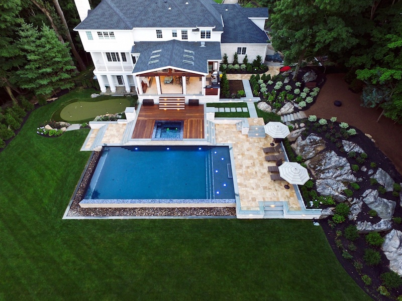 Landscape and swimming pool photo shot by a drone by Neave Group
