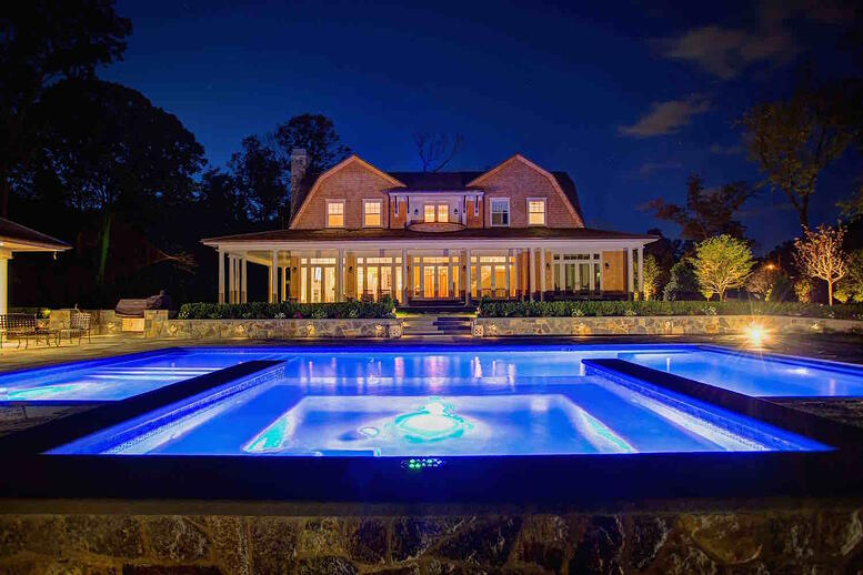 A landscaping project by Neave Pools photographed at night