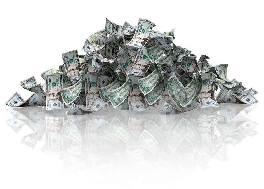 Pile of dollars - isolated over a white background.jpeg
