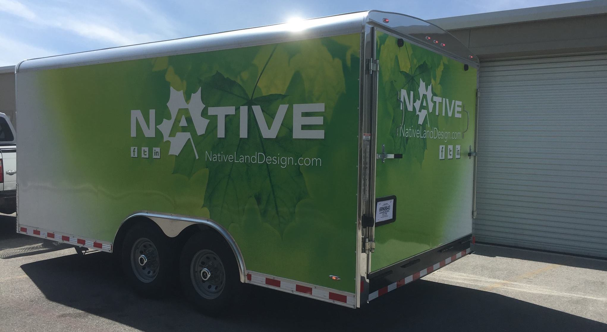 Wrapping landscaping and mowing trailers will get your company great exposure.